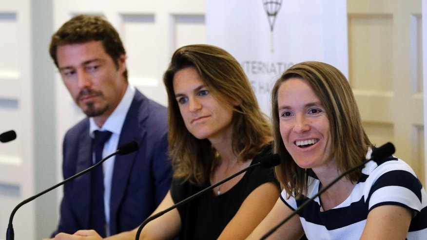 From left, Marat Safin, of Russia, Amelie Mauresmo, of France, and Justine Henin, of Belgium, participate in a news conference prior to their enshrinement ceremony at the International Tennis Hall of Fame, Saturday, July 16, 2016, in Newport, R.I. (AP Photo/Elise Amendola)