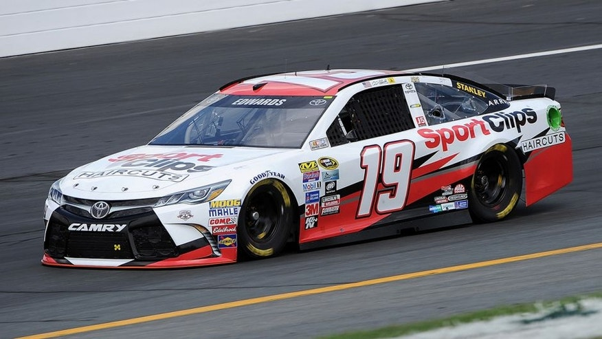 LOUDON, NH - JULY 15: Carl Edwards, driver of the #19 Sport Clips Toyota, practices for the NASCAR Sprint Cup Series New Hampshire 301 at New Hampshire Motor Speedway on July 16, 2016 in Loudon, New Hampshire. (Photo by Jonathan Moore/Getty Images)