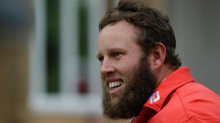 Andrew Johnston of England smiles after completing his third round of the British Open Golf Championship on the 18th green at the Royal Troon Golf Club in Troon, Scotland, Saturday, July 16, 2016.(AP Photo/Matt Dunham)