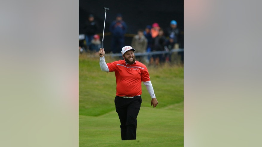 Andrew Johnston of England raises his club and smiles on the 18th green during the third round of the British Open Golf Championship at the Royal Troon Golf Club in Troon, Scotland, Saturday, July 16, 2016. (AP Photo/Matt Dunham)