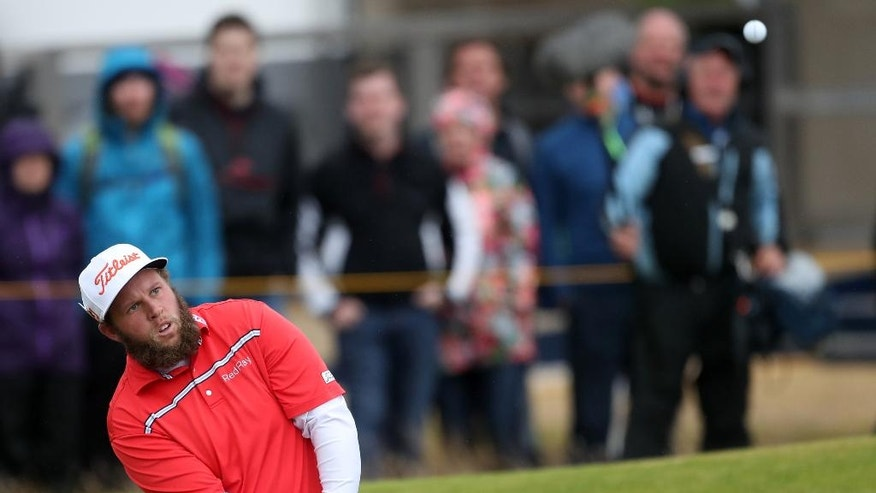 Andrew Johnston of England  chips onto the 18th green during the third round of the British Open Golf Championship at the Royal Troon Golf Club in Troon, Scotland, Saturday, July 16, 2016. (AP Photo/Peter Morrison)