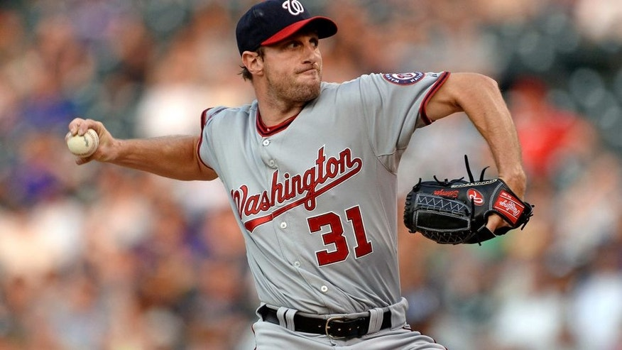 Aug 20, 2015; Denver, CO, USA; Washington Nationals starting pitcher Max Scherzer (31) delivers a pitch in the first inning against the Colorado Rockies at Coors Field. Mandatory Credit: Ron Chenoy-USA TODAY Sports