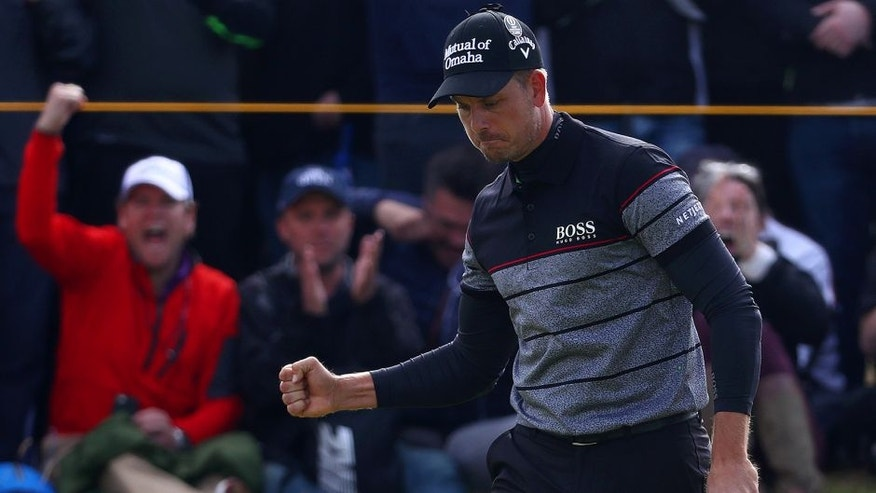 TROON, SCOTLAND - JULY 17: Henrik Stenson of Sweden celebrates a putt on the 14th during the final round on day four of the 145th Open Championship at Royal Troon on July 17, 2016 in Troon, Scotland. (Photo by Matthew Lewis/Getty Images)