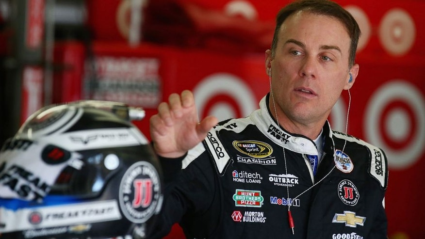 LOUDON, NH - JULY 15: Kevin Harvick, driver of the #4 Jimmy John's Chevrolet, stands in the garage area during practice for the NASCAR Sprint Cup Series New Hampshire 301 at New Hampshire Motor Speedway on July 16, 2016 in Loudon, New Hampshire. (Photo by Sarah Crabill/NASCAR via Getty Images)