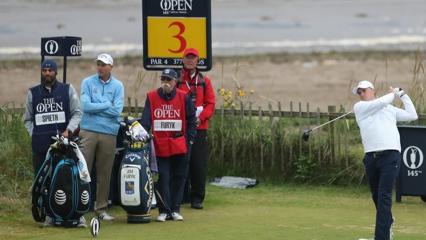Jordan Spieth of the United States, right, watched by playing partner Jim Furyk of the United States, second left, plays off the 3rd tee during the final round of the British Open Golf Championship at the Royal Troon Golf Club in Troon, Scotland, Sunday, July 17, 2016. (AP Photo/Peter Morrison)