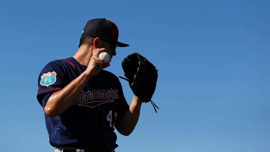 Minnesota Twins pitcher Ricky Nolasco winds up for a throw during a spring training baseball workout in Fort Myers, Fla., Monday, Feb. 22, 2016.