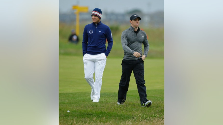 Emiliano Grillo of Argentina. left and Rory McIlroy of Northern Ireland walk up the 3rd fairway during the final round of the British Open Golf Championship at the Royal Troon Golf Club in Troon, Scotland, Sunday, July 17, 2016. (AP Photo/Matt Dunham)