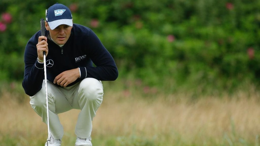Martin Kaymer of Germany looks at the line of his putt on the 1st green during the final round of the British Open Golf Championship at the Royal Troon Golf Club in Troon, Scotland, Sunday, July 17, 2016. (AP Photo/Matt Dunham)