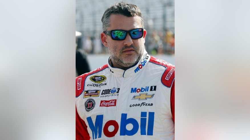 In this photo taken Friday July 15, 2016 Tony Stewart is seen before qualifying at New Hampshire Motor Speedway for Sunday's New Hampshire 301 auto race in Loudon, N.H. Stewart finished Sunday's race second and strengthened his spot inside the top 30 in the points standings.  (AP Photo/Jim Cole)
