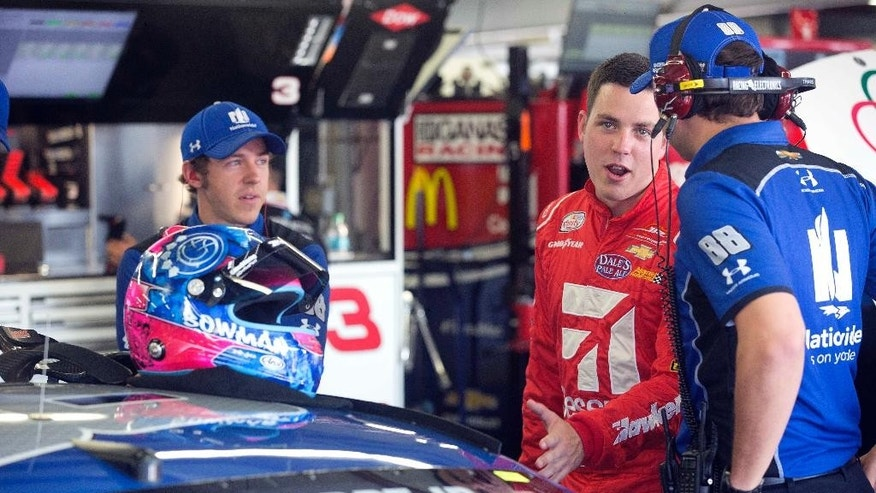Alex Bowman, center, smiles as he talks with the crew of Dale Earnhardt Jr. before practice Friday July 15, 2016 at New Hampshire Motor Speedway in Loudon, N.H. Bowman will take Earnhardt's place for Sunday's New Hampshire 301 auto race after it was announced that Earnhardt will miss the race due to concussion-like symptoms. (AP Photo/Jim Cole)