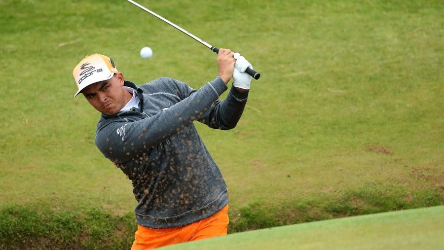 Rickie Fowler of the United States play out of a bunker on the 8th green during the final round of the British Open Golf Championship at the Royal Troon Golf Club in Troon, Scotland, Sunday, July 17, 2016. (AP Photo/Peter Morrison)
