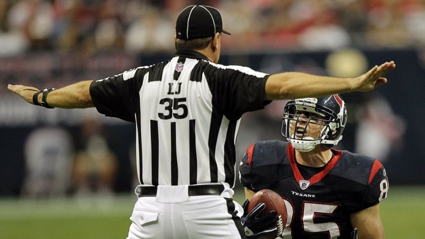 HOUSTON - OCTOBER 09: Tight-end Joel Dreessen #85 of the Houston Texans pleads with line judge John Hussey #35 after a pass was ruled incomplete during action against the Oakland Raiders at Reliant Stadium on October 9, 2011 in Houston, Texas. (Photo by Bob Levey/Getty Images)