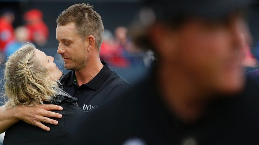 Henrik Stenson of Sweden looks at his wife Emma Lofgren as they embrace after he won the British Open Golf Championships at the Royal Troon Golf Club in Troon, Scotland, Sunday, July 17, 2016.(AP Photo/Matt Dunham)