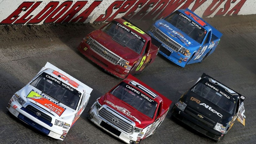 ROSSBURG, OH - JULY 22: Ken Schrader, driver of the #52 Federated Auto Parts Toyota, leads a group of cars during qualifying races for the NASCAR Camping World Truck Series 3rd Annual 1-800-Car-Cash Mud Summer Classic at Eldora Speedway on July 22, 2015 in Rossburg, Ohio. (Photo by Sean Gardner/NASCAR via Getty Images)