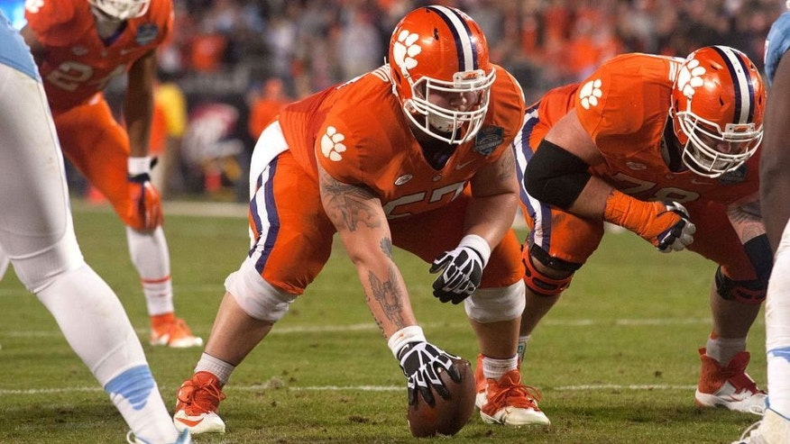 Dec 5, 2015; Charlotte, NC, USA; Clemson Tigers center Jay Guillermo (57) prepares to snap the ball during the second half against the North Carolina Tar Heels in the ACC football championship game at Bank of America Stadium. Clemson defeated North Carolina 45-37. Mandatory Credit: Jeremy Brevard-USA TODAY Sports