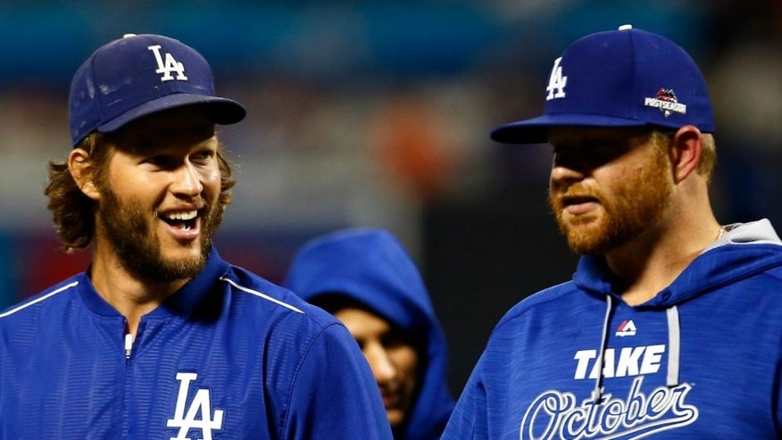 during game four of the National League Division Series at Citi Field on October 13, 2015 in New York City.,NEW YORK, NY - OCTOBER 13: Clayton Kershaw #22 and Brett Anderson #35 of the Los Angeles Dodgers smile after defeating the New York Mets in game four of the National League Division Series at Citi Field on October 13, 2015 in New York City. The Dodgers defeated the Mets with a score of 3 to 1. (Photo by Mike Stobe/Getty Images)
