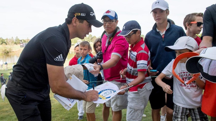 Jason Day, of Australia, signs autographs during the Pro-Am for the Canadian Open golf tournament at Glen Abbey in Oakville, Ontario, Wednesday, July 20, 2016. (Frank Gunn/The Canadian Press via AP)