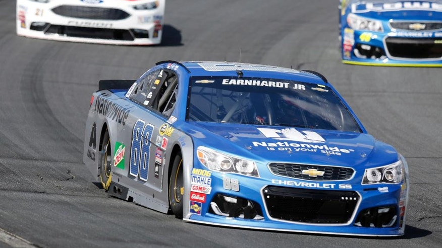 Alex Bowman (88) driving for Dale Earnhardt Jr., leads Ryan Blaney (21) and Jimmie Johnson (48) during practice at New Hampshire Motor Speedway for Sunday's NACAR Sprint Cup Series auto race Saturday, July 16, 2016, in Loudon, N.H. (AP Photo/Jim Cole)