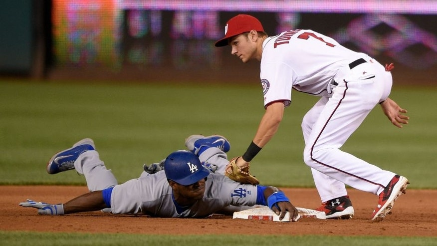 Los Angeles Dodgers' Yasiel Puig, bottom, is safe as he stole second against Washington Nationals second baseman Trea Turner (7) during the fifth inning of a baseball game, Tuesday, July 19, 2016, in Washington. The Dodgers won 8-4. (AP Photo/Nick Wass)