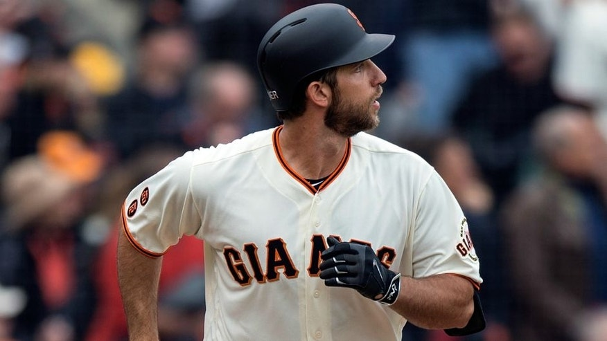 SAN FRANCISCO, CA - APRIL 09: Madison Bumgarner #40 of the San Francisco Giants hits a home run against the Los Angeles Dodgers during the second inning at AT&T Park on April 9, 2016 in San Francisco, California. The Los Angeles Dodgers defeated the San Francisco Giants 3-2 in 10 innings. (Photo by Jason O. Watson/Getty Images)
