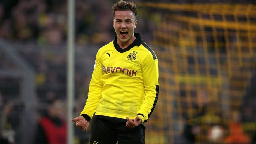 DORTMUND, GERMANY - NOVEMBER 17: Mario Goetze of Dortmund celebrates scoring the third goal during the Bundesliga match between Borussia Dortmund and SpVgg Greuther Fuerth at Signal Iduna Park on November 17, 2012 in Dortmund, Germany. (Photo by Friedemann Vogel/Bongarts/Getty Images)