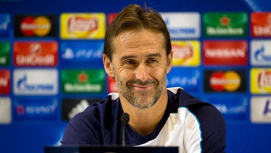 FILE - In this Tuesday, Nov. 3, 2015 file photo, Porto's then head coach Julen Lopetegui smiles during a press conference ahead of a group G Champions League soccer match against Maccabi Tel Aviv in Haifa, Israel. Spain's soccer federation on Thursday, July 18, 2016 says Julen Lopetegui is the new coach of the national team. Lopetegui replaces Vicente Del Bosque, who resigned after Spain's elimination in the round of 16 of the European Championship last month. (AP Photo/Ariel Schalit, file)
