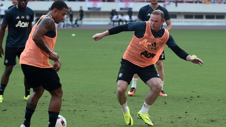 SHANGHAI, CHINA - JULY 21: Wayne Rooney (R) of Manchester United attends first team training session as part of their pre-season tour of China during the 2016 International Champions Cup football match between Manchester United and Dortmund on July 21, 2016 in Shanghai, China. (Photo by VCG)***_***