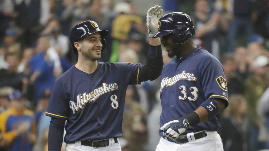 The Milwaukee Brewers' Chris Carter (right) is congratulated by Ryan Braun after hitting a two-run home run during the third inning against the Miami Marlins on Sunday, May 1, 2016, in Milwaukee.