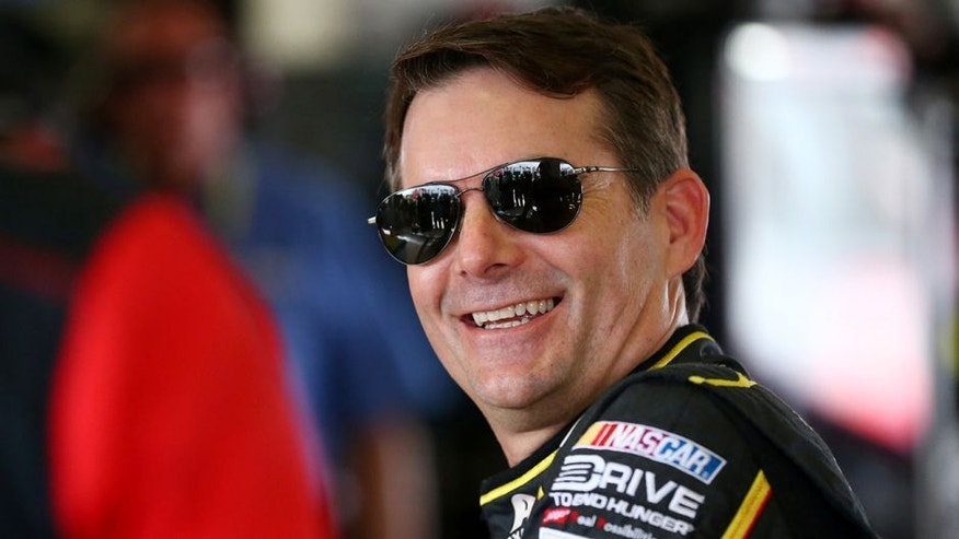 HOMESTEAD, FL - NOVEMBER 20: Jeff Gordon, driver of the #24 AXALTA Chevrolet, stands in the garage area during practice for the NASCAR Sprint Cup Series Ford EcoBoost 400 at Homestead-Miami Speedway on November 20, 2015 in Homestead, Florida. (Photo by Sarah Crabill/Getty Images)