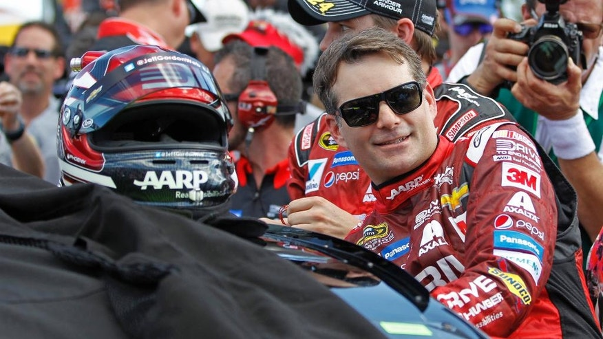 FILE - In this Feb. 22, 2015, file photo, Jeff Gordon climbs into his car before the Daytona 500 NASCAR Sprint Cup series auto race at Daytona International Speedway in Daytona Beach, Fla. Dale Earnhardt Jr. will miss two more races as he recovers from concussion-like symptoms and retired NASCAR champion Jeff Gordon will replace him at Indianapolis and Pocono. The announcement came Wednesday, July 20, 2016, from Hendrick Motorsports, which said Earnhardt has not been cleared by doctors to drive.  (AP Photo/Terry Renna, File)