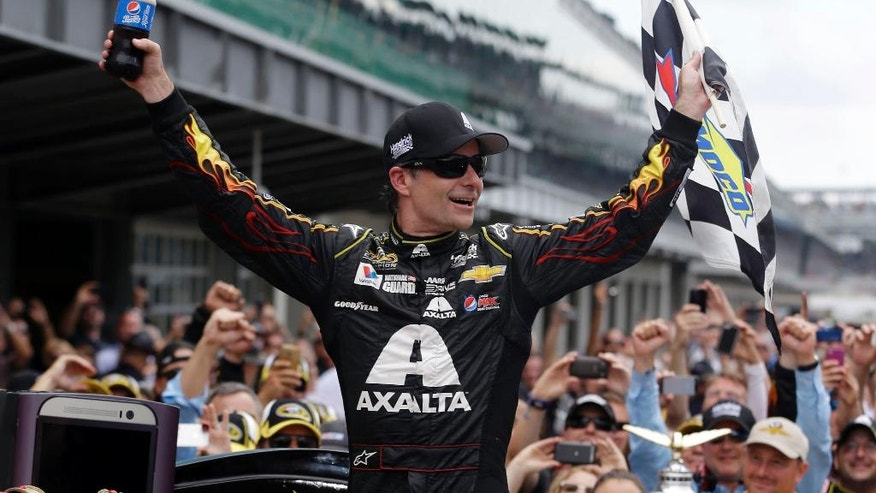 FILE - In this July 27, 2014, file photo, Jeff Gordon celebrates after winning the NASCAR Brickyard 400 auto race at Indianapolis Motor Speedway in Indianapolis. Gordon will get one more shot to win in Indianapolis this weekend when he replaces Earnhardt Jr. in the No. 88 car.  On Wednesday, July 20, 2016, Hendrick Motorsports announced that Earnhardt would miss the next two weeks as he continues to battle balance issues and nausea. (AP Photo/Darron Cummings, File)