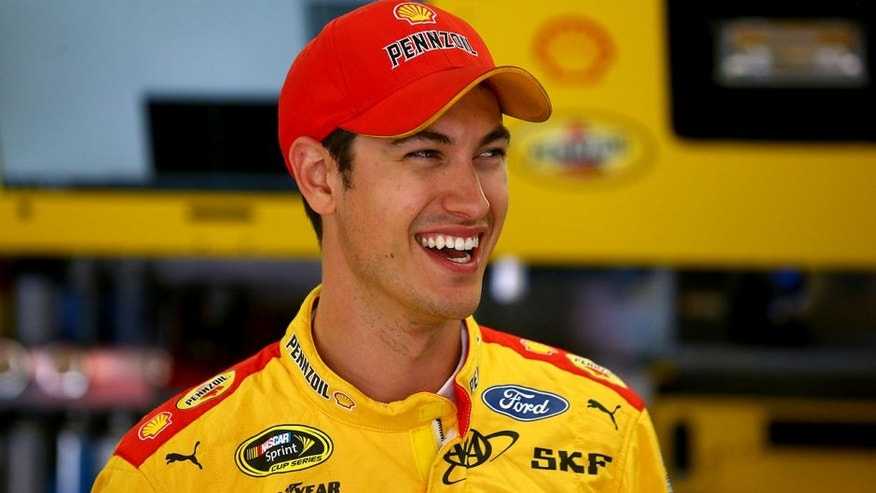 LOUDON, NH - JULY 16: Joey Logano, driver of the #22 Shell Pennzoil Ford, stands in the garage area during practice for the NASCAR Sprint Cup Series New Hampshire 301 at New Hampshire Motor Speedway on July 16, 2016 in Loudon, New Hampshire. (Photo by Sarah Crabill/NASCAR via Getty Images)