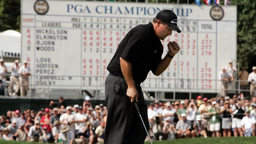 FILE - In this Aug. 15, 2005, file photo, Phil Mickelson reacts as his birdie putt falls on the 18th hole during the final round of the lightning-delayed PGA Championship at Baltusrol Golf Club in Springfield, N.J. Mickelson won the tournament. The PGA Championship returns to Baltusrol the last week of July.  Golf is back in the Olympics for the first time since 1904, a dozen years before the PGA Championship was held for the first time. To make room on the schedule, the PGA Championship agreed to move up to the final weekend of July ahead of the Rio Games. (AP Photo/Julie Jacobson, File)