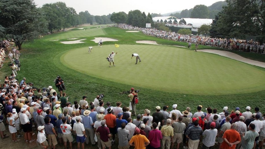 FILE - In this Aug. 13, 2005, file photo, Phil Mickelson, center, checks out his putt as he plays the 17th hole with playing partner Jerry Kelly during the third round of the PGA Championship at Baltusrol Golf Club in Springfield, N.J. This year's PGA Championship will be held at Baltusrol the last week of July. (AP Photo/Mel Evans, File)