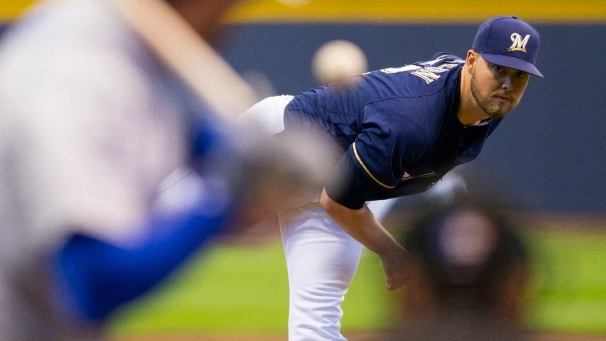 Milwaukee Brewers pitcher Jimmy Nelson throws a pitch during the first inning against the Chicago Cubs.