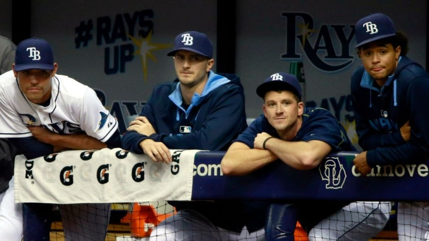 Jun 30, 2015; St. Petersburg, FL, USA; Tampa Bay Rays starting pitcher Alex Cobb (53), pitcher Matt Moore (55), pitcher Jake Odorizzi (23), pitcher Drew Smyly (33) and pitcher Chris Archer (22) look on from the dugout during the second inning against the Cleveland Indians at Tropicana Field. Mandatory Credit: Kim Klement-USA TODAY Sports