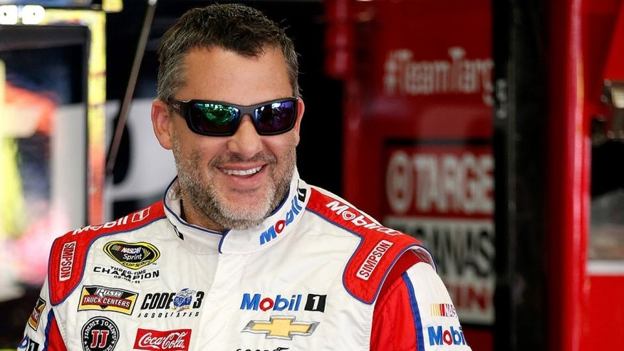 LOUDON, NH - JULY 15: Tony Stewart, driver of the #14 Haas Automation Chevrolet, stands in the garage area during practice for the NASCAR Sprint Cup Series New Hampshire 301 at New Hampshire Motor Speedway on July 16, 2016 in Loudon, New Hampshire. (Photo by Todd Warshaw/NASCAR via Getty Images)