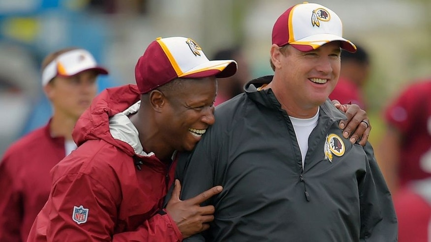 RICHMOND VA, JULY 27: Washington defensive backs coach Raheem Morris, left, shares a laugh with head coach Jay Gruden as they walk off the field after a morning practice on the 4th day of the Washington Redskins training camp in Richmond VA, July 27, 2014. (Photo by John McDonnell/The Washington Post via Getty Images)