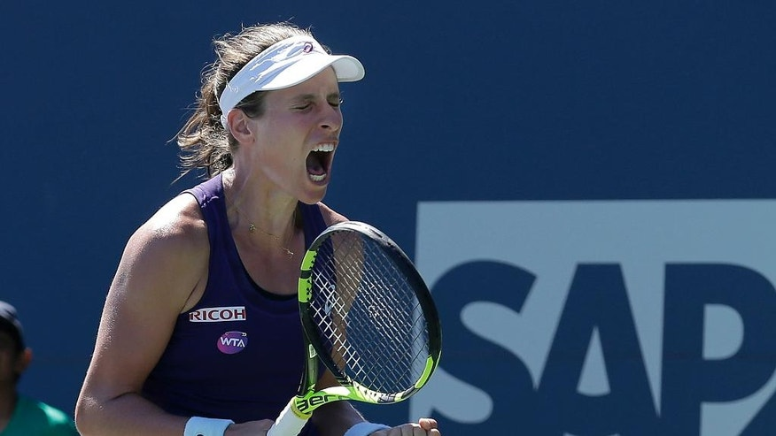 Johanna Konta, of Britain, celebrates after defeating Dominika Cibulkova, of Slovakia, during a semifinal in the Bank of the West Classic tennis tournament in Stanford, Calif., Saturday, July 23, 2016. (AP Photo/Jeff Chiu)