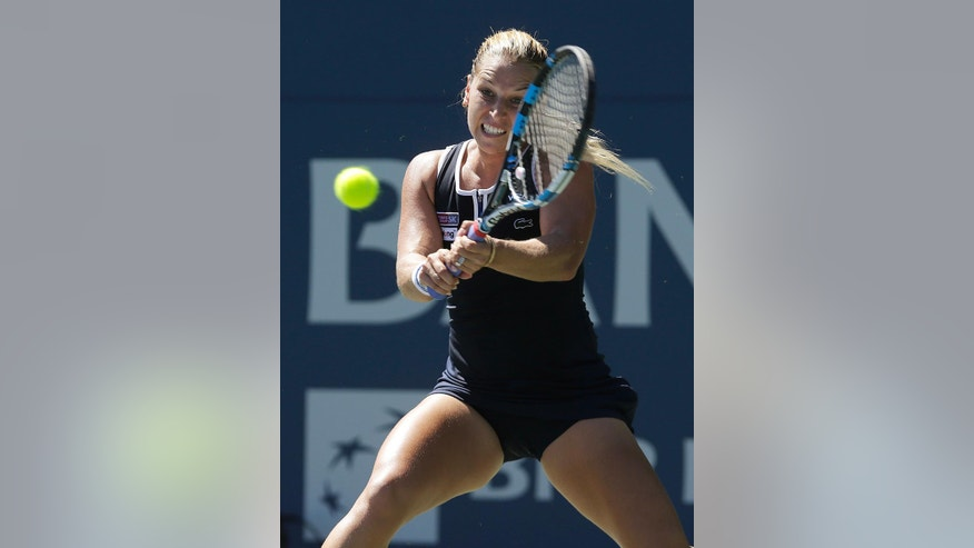Dominika Cibulkova, of Slovakia, returns to Johanna Konta, of Britain, during a semifinal in the Bank of the West Classic tennis tournament in Stanford, Calif., Saturday, July 23, 2016. Konta won 6-4, 6-2. (AP Photo/Jeff Chiu)