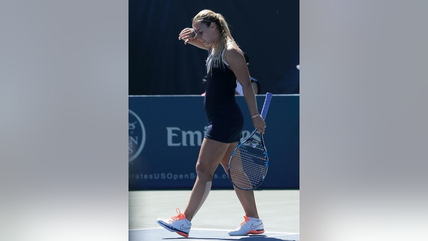 Dominika Cibulkova, of Slovakia, reacts after losing a point to Johanna Konta, of Britain, during a semifinal in the Bank of the West Classic tennis tournament in Stanford, Calif., Saturday, July 23, 2016. (AP Photo/Jeff Chiu)