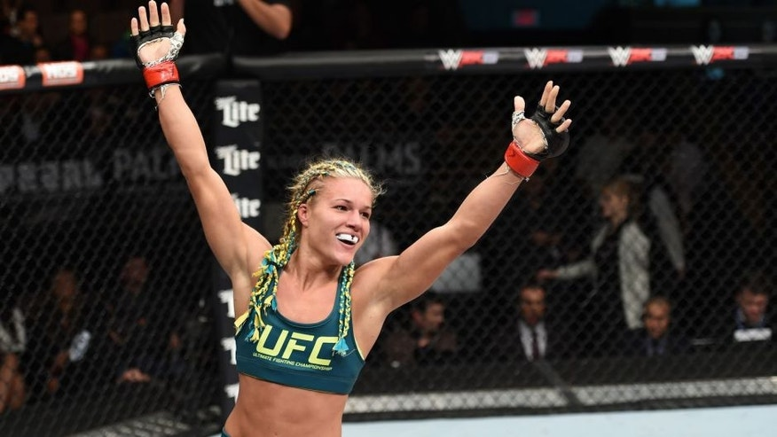 LAS VEGAS, NEVADA - DECEMBER 12: Felice Herrig celebrates her submission victory over Lisa Ellis in their strawweight fight during The Ultimate Fighter Finale event inside the Pearl concert theater at the Palms Casino Resort on December 12, 2014 in Las Vegas, Nevada. (Photo by Jeff Bottari/Zuffa LLC/Zuffa LLC via Getty Images)