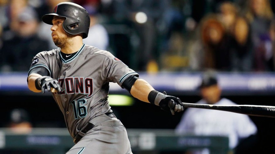 Arizona Diamondbacks' Chris Owings follows the flight of his RBI-single off Colorado Rockies relief pitcher Chris Rusin in the sixth inning of a baseball game Tuesday, May 10, 2016, in Denver. (AP Photo/David Zalubowski)