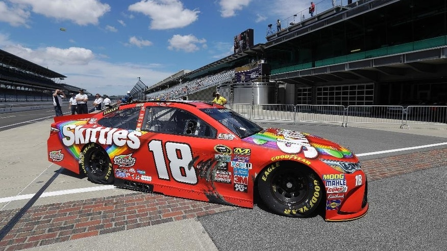 Sprint Cup Series driver Kyle Busch (18) pulls onto pit road during practice for the Brickyard 400 NASCAR auto race at Indianapolis Motor Speedway in Indianapolis, Friday, July 22, 2016. (AP Photo/Darron Cummings)