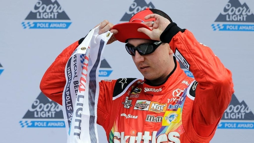 Sprint Cup Series driver Kyle Busch (18) adjust his hat after winning the pole for the Brickyard 400 NASCAR auto race at Indianapolis Motor Speedway in Indianapolis, Saturday, July 23, 2016. (AP Photo/Darron Cummings)