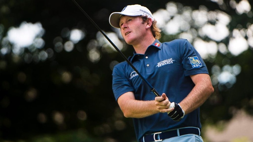 Brandt Snedeker, of the United States, tees off on the 11th hole at the Canadian Open golf tournament in Oakville, Ontario, on Saturday, July 23, 2016. (Nathan Denette/The Canadian Press via AP)