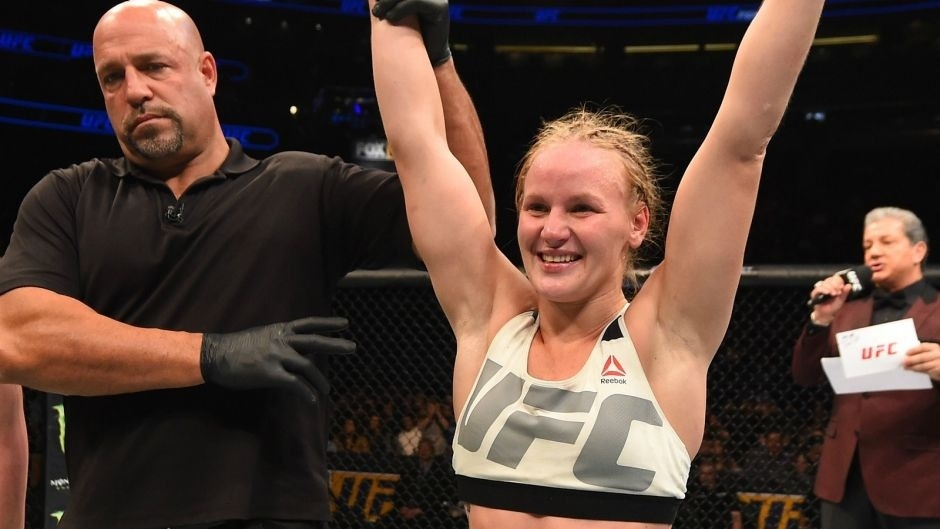 ORLANDO, FL - DECEMBER 19: (R-L) Valentina Shevchenko celebrates her victory over Sarah Kaufman in their women's bantamweight bout during the UFC Fight Night event at the Amway Center on December 19, 2015 in Orlando, Florida. (Photo by Josh Hedges/Zuffa LLC/Zuffa LLC via Getty Images)