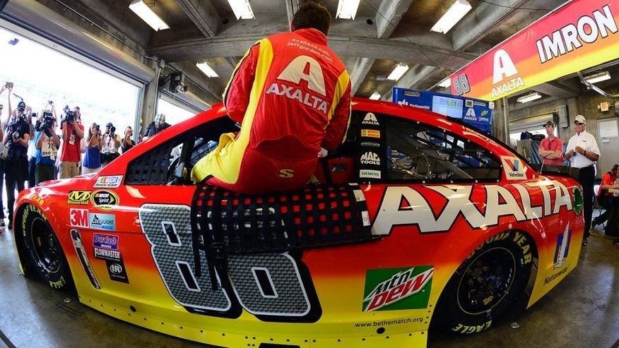 INDIANAPOLIS, IN - JULY 22: Jeff Gordon, driver of the #88 Axalta Chevrolet, prepares to drive during practice for the NASCAR Sprint Cup Series Crown Royal presents the Combat Wounded Coalition 400 at the Brickyard at Indianapolis Motor Speedway on July 23, 2016 in Indianapolis, Indiana. (Photo by Robert Laberge/Getty Images)
