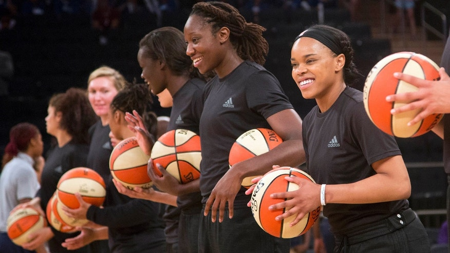 July 13, 2016: Members of the New York Liberty basketball team await the start of a game against the Atlanta Dream, in New York.
