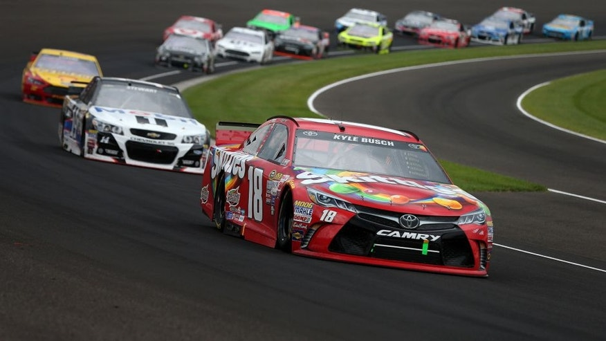 INDIANAPOLIS, IN - JULY 26: Kyle Busch, driver of the #18 Skittles Toyota, leads a pack of cars during the NASCAR Sprint Cup Series Crown Royal Presents the Jeff Kyle 400 at the Brickyard at Indianapolis Motor Speedway on July 26, 2015 in Indianapolis, Indiana. (Photo by Brian Lawdermilk/Getty Images)